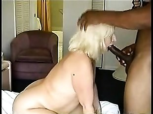 Mature blonde big tittied milf spreads for big cock