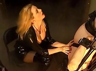 Powerless Villein Receives Tutored by Golden-Haired Domina in Latex