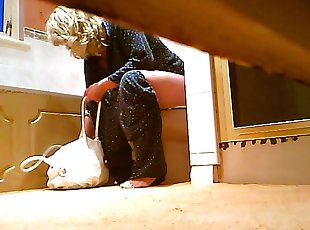Blonde fem caught on spy cam pissing on toilet with phone